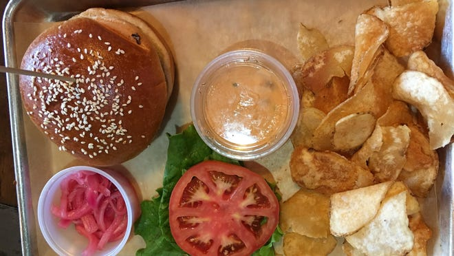 The Retro burger at Quam's comes withwith special sauce, lettuce, cheese and pickled onions.