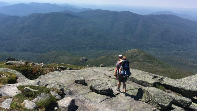 Justin Ray and his daughter June Ray hike along the Algonquin Mountain in the Adirondacks in 2016.