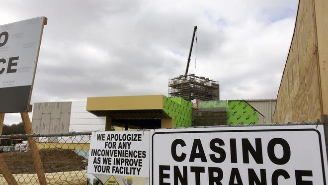 In this April 13, 2017, photo, a crane towers over construction work at the Ho-Chunk Nation's casino in Wittenberg, Wis. The Ho-Chunk is adding a hotel and a restaurant to the site, stoking fears from rival Stockbridge-Munsee Band of Mohicans that the expanded facility will hurt business at that tribe's nearby North Star casino.