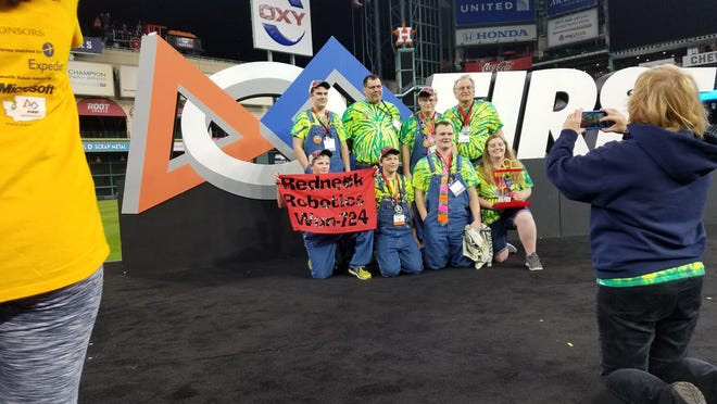 The Sun River Valley Robotics Club, which includes high schoolers from Fairfield, Great Falls and Sun River Valley, poses with their trophy after they topped 127 other robotics teams at the FIRST World Championship Competitions in front of more than 20,000 spectators in Minute Maid Stadium in Houston, Texas.