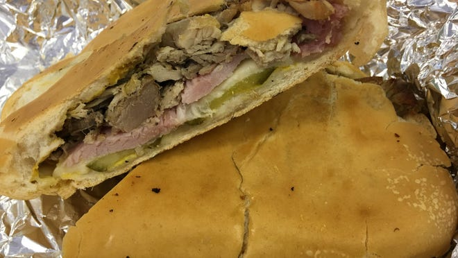 The Cuba Libre, Over the Top Sammie's version of the Cuban sandwich, was a good one: The bread is the real deal. The sliced ham was positively terrific; and the pickles were crisp. The pork was unadorned, pulled, mojo-marinated meat.