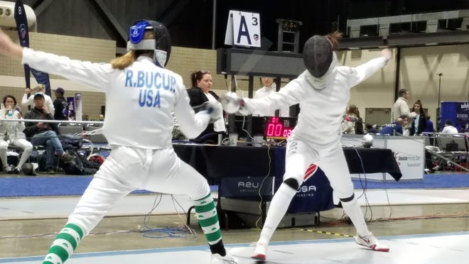 Rebekah Bucur, left, duels with Audrey Chu in the Division 3 Epee Fencing Final USA Fencing Nationals in Salt Lake City.