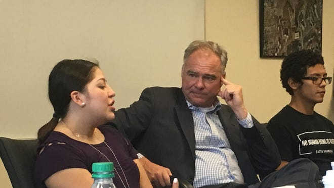 Sen. Tim Kaine, D-Va., center, listens to Alexandra Duran, left, a 21-year-old student at Marymount University who had been in the United States illegally since she was 5 years old. Ricardo Amaya, 26, a student at George Mason University also from El Salvador, is at right. Both Duran and Amaya have been shielded from deportation and have been able to get financial aid and work permits through Deferred Action for Childhood Arrivals, the Obama-era program that President Donald Trump could rescind as soon as Tuesday. MUST CREDIT: Washington Post photo by Maria Sacchetti