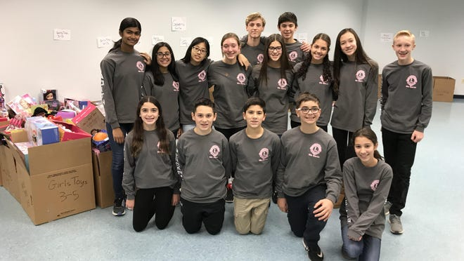 Warren Middle School students spent part of Friday at the United Way of Northern New Jersey Gifts of the Season distribution center, organizing boxes and boxes of toys that will be distributed to several thousand recipients for the holidays.