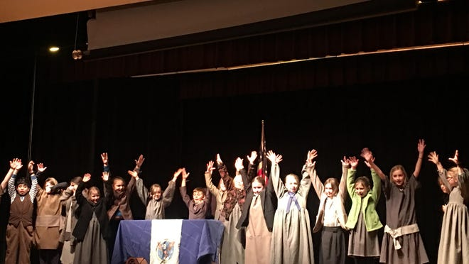 """President Roosevelt & the residents of Hooverville during the production of """"Annie Jr. The Musical"""" at the Hunt Middle School in Burlington. Finn Mathy portrayed President Roosevelt."""