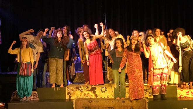 """Members of the Very Merry Theatre production of """"Hair"""" perform a song from the musical."""