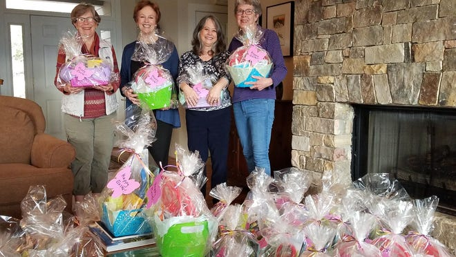 Helping to assemble the Easter baskets are (from left) Libba Fairleigh, Junith Koon, Mary Jo Clark, and Suzanne Money.