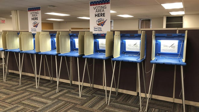 In this Sept. 20, 2018 photo, voting booths stand ready in downtown Minneapolis for the opening of early voting in Minnesota. Election officials and federal cybersecurity agents are touting improved collaboration aimed at confronting and deterring efforts to tamper with elections. Granted, the only way to go was up: In 2016 amid Russian meddling, federal officials were accused first of being too tight-lipped on intelligence about possible hacking into state systems, and later criticized for trying to hijack control from the states. The first test of this new-and-improved relationship could come on Nov. 6. (AP Photo/Steve Karnowski)