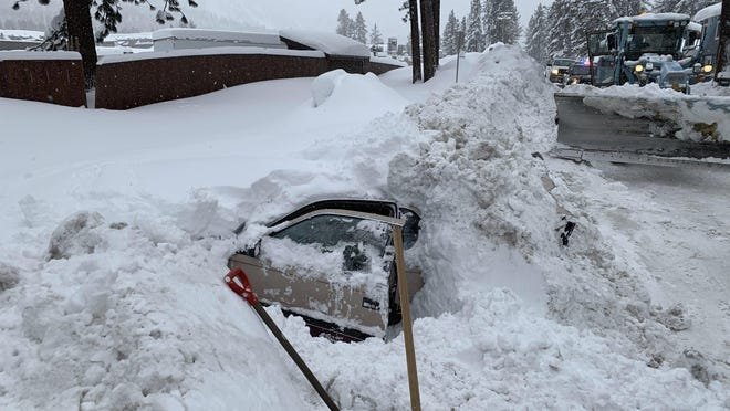 This Feb. 17, 2019 photo provided by City of South Lake Tahoe shows a car buried in snow in South Lake Tahoe, Calif. Chris Fiore, spokesman for the city of South Lake Tahoe, highlighted the Feb. 17 incident in a Tuesday, Feb. 26 news release in order to urge safety precautions in winter weather.
