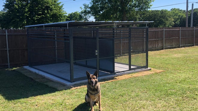 Ardmore Police Department K-9 Boss sits outside his new kennel completed on Saturday, May 30. Heroes with Hope of Southern Oklahoma helped raise money for the kennel and is seeking further donations for two more.