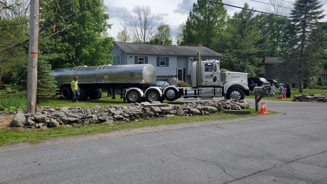 A water tanker was delivered on Wednesday to a home on Old Country Road in Monroe that has had water shortages. The Village of Kiryas Joel supplied the tanker as a temporary step until it can connect the home to a municipal service line that Kiryas Joel installed on the street. PROVIDED PHOTO