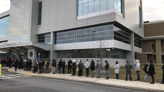 Undocumented immigrants wait outside the Department of Motor Vehicles office at the Orange County Government Center in Goshen on Tuesday morning to apply for learner's permits, the first step in getting a driver's license. The county has issued 1,014 permits to immigrants since a new law allowing them to get licenses took effect on Dec. 16.