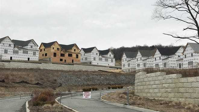 The developer of the 181-home Smith Farm project under construction in Monroe has filed a federal lawsuit accusing the Village of Monroe of creating obstacles to try to block new housing for Hasidic families.