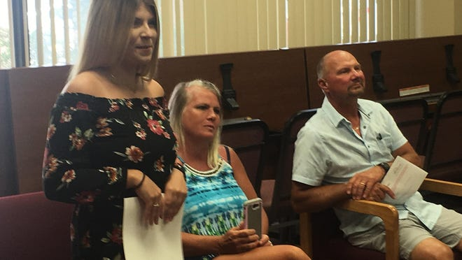 "From left, MaKayla Brownlee appears at a Wellington City Council meeting with her parents, Michelle Brownlee and Mark Brownlee, Sr. Mayor Jim Valentine honored MaKayla Brownlee, an ""American Idol"" contestant with a special day."