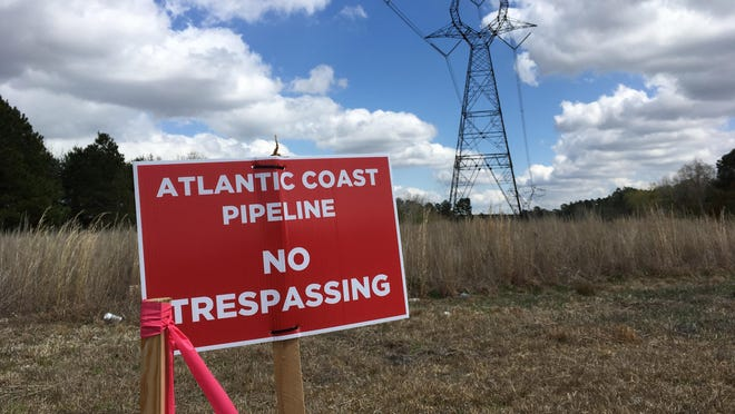 In this photo from March of 2018, a 'No Trespassing' sign marks an area where the Atlantic Coast Pipeline was to have run near Yarborough Road in the Gray's Creek area. Duke Energy and Dominion Energy have canceled the project.