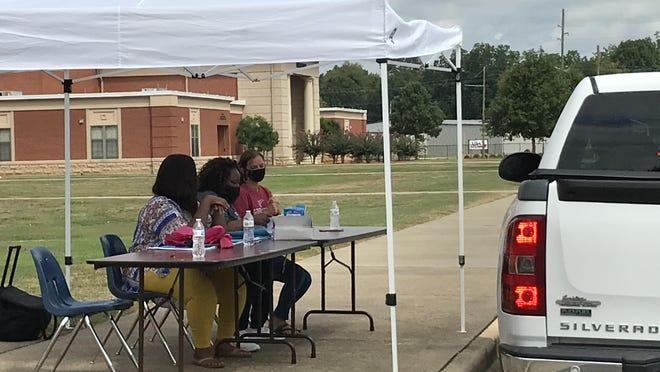 Gadsden City High staffers manned a Chromebook pick-up station Friday as students prepare to resume school -- online only to start with -- Monday. Gadsden City School leaders want to bring students back to campus as soon as it is safe to do so.