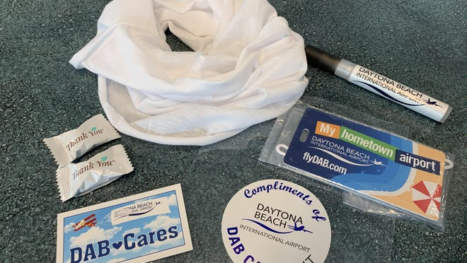 "These are the contents of the ""DAB Cares"" personal coronavirus safety kits, pictured on Friday, June 12, 2020. Daytona Beach International Airport plans to soon hand out the kits to all departing air travelers as part of its new ""Ready to Fly"" initiative to stop the spread of COVID-19 and to assure the public that it is safe to fly."