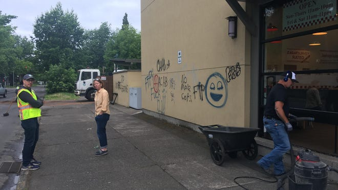 Sarah Medary, Eugene city manager (center), visits businesses that were vandalized near West Seventh Avenue and Jefferson Street. [Matthew D. Denis/The Register-Guard file] - registerguard.com