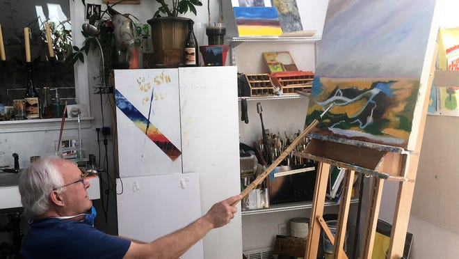 Artist Robert Canaga takes a different perspective in painting a landscape from his mind's eye.