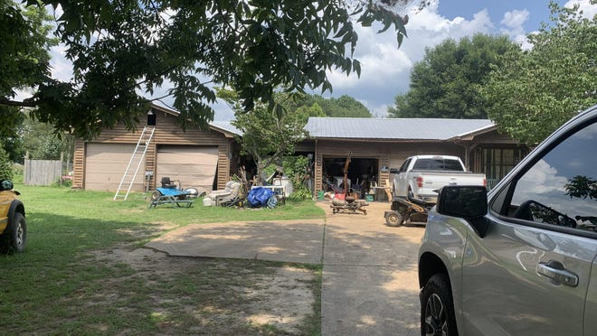 Several law enforcement agencies were engaged in a standoff Tuesday at this location. The standoff ended when the man, barricaded in the attic above a garage, apparently shot himself.