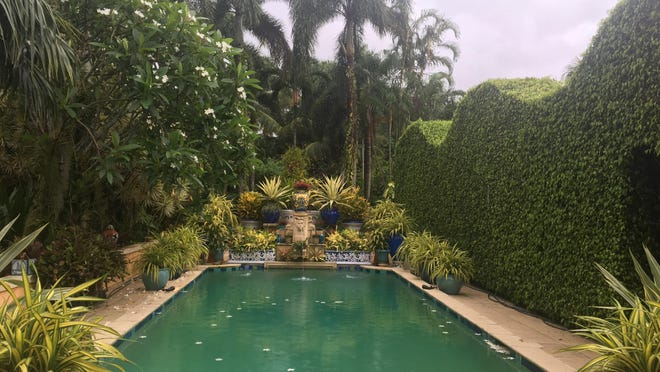 Even under a cloudy sky, the pool at Casa Phippsberger in Palm Beach has a tropical ambience that is both welcoming and relaxing.