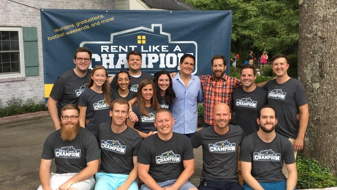 Shark Tank investors Mark Cuban and Chris Sacca (back row, fourth and third from the right) pose with members of Chicago-based Rent Like A Champion. The company facilitates home rentals during sporting events, and is looking for potential renters ahead of next month's Honda Classic golf tournament.