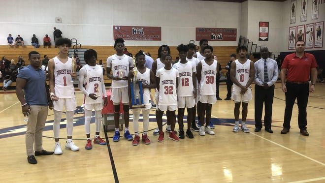 The Forest Hill boys basketball poses for a photo after winning its New Year's tournament on Saturday in West Palm Beach. The Falcons beat Lake Worth 88-65.