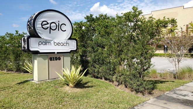A fitted plastic tarp covered the sign post of the former Double Dee's Ranch strip club in West Palm Beach on Tuesday, Jan. 29. Epic Palm Beach, a fully-nude adult nightclub opened the following day.