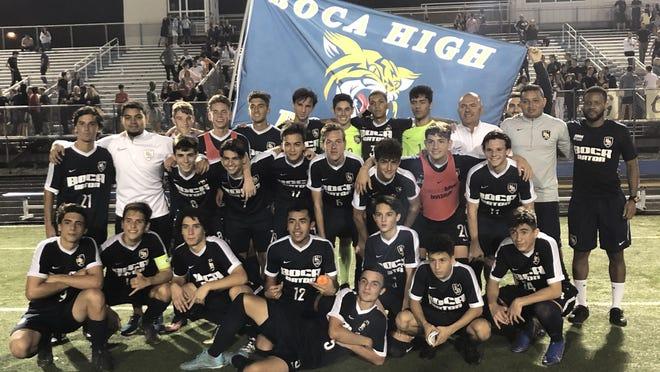 The Boca Raton boys soccer team celebrates its regional soccer championship Wednesday night.