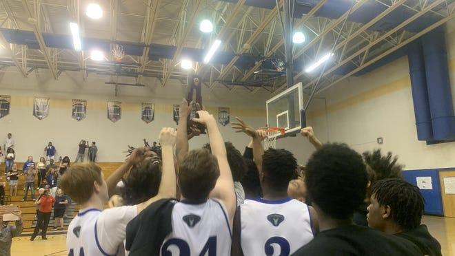 Park Vista's boys basketball team celebrates winning the Class 7A-District 11 title at Boca Raton High on Friday night.