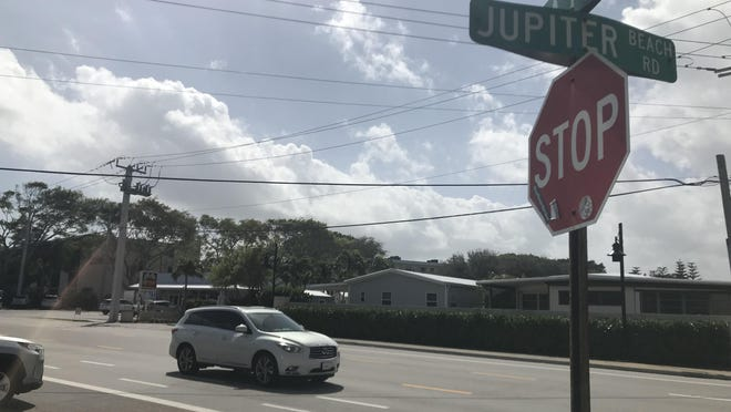 Cars drive through the intersection of A1A and Jupiter Beach Road.