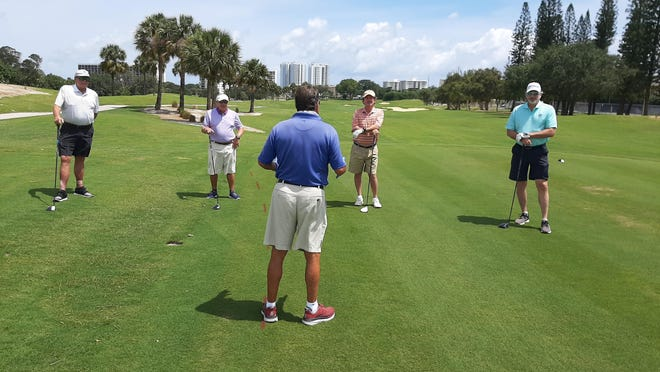 Golfers returned to the North Palm Beach Country Club Wednesday for the first time in a month. Staffers are instructing everyone at the first hole about social distancing protocols and other new rules.