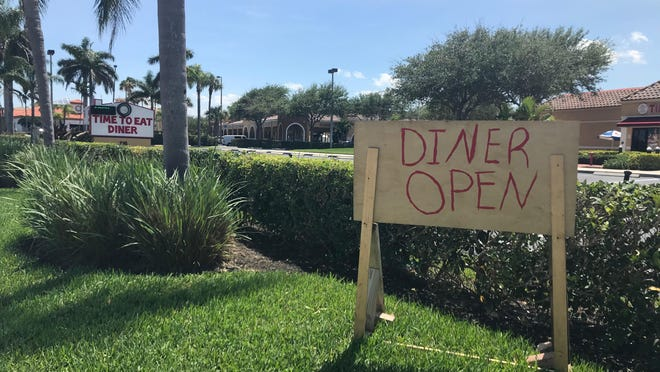 A homemade sign is posted outside Time to Eat Diner in Tequesta this week.