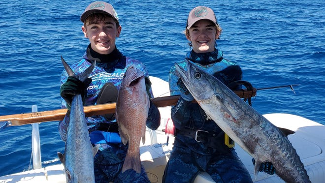 Reese Gallagher (left) and Nick Bailey speared these two impressive king mackerel and mangrove snapper while freediving in 70 feet of water off of the Loran Tower.