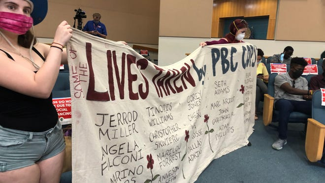 Protesters against police brutality filed into county commission chambers on Tuesday to ask for a community discussion on policing practices.