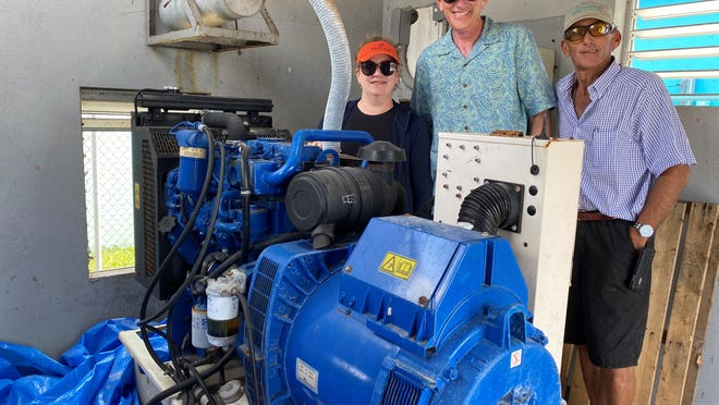 Volunteers pose with a donated generator at Man-O-War Cay in the Bahamas. Since September, The Community Foundation for Palm Beach and Martin Counties has deployed more than $1 million in disaster relief aid to portions of the hurricane-ravaged nation. Pictured are (from left): Amy Simion of Eagles' Wings,  Brad Hurlburt of The Community Foundation, and boat captain Don Carson, Jr.