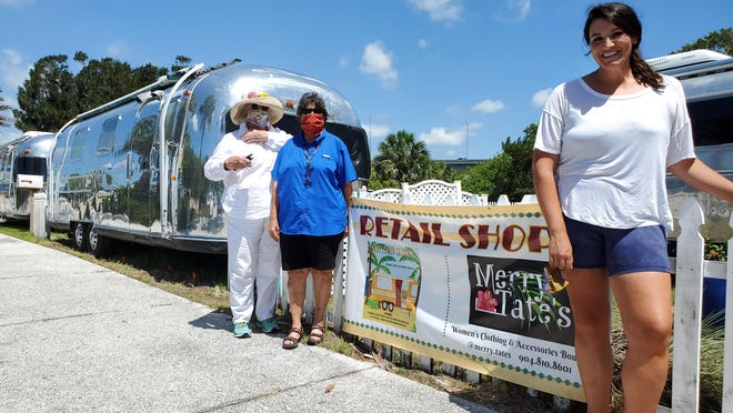 Airstream Row property owners Anna McFadden and Barrie Jo Price, left, stand next to Mary Kate Radloff, owner of Merry Tate's boutique, in Vilano Beach Wednesday, June 24, 2020.