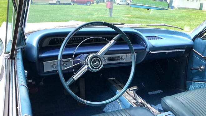 The Impala has a 327 engine, automatic transmission, chrome rims, power steering and power brakes.
