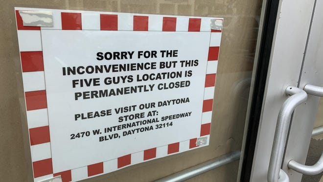 A sign on the front door of the shuttered Five Guys restaurant at The Pavilion at Port Orange shopping center states that it is permanently closed on May 26, 2020. The coronavirus pandemic could cause an increase in retail and office vacancies throughout the country, industry watchers say.