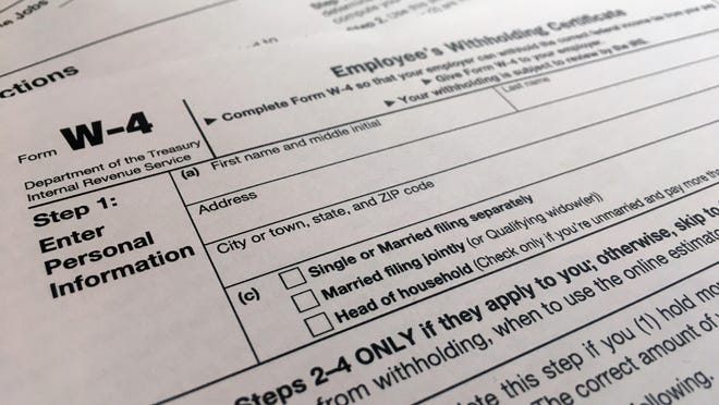 FILE - This Wednesday, Feb. 5, 2020 photo shows the W-4 form in New York.   The majority of individual taxpayers in the U.S. are eligible to file their taxes for free, yet many may be unaware or confused by how to do so.    Improvements have been made and Free File should be easier to use in 2020. But, with tax season getting into full gear, users should be aware of the details of the service and alternatives.