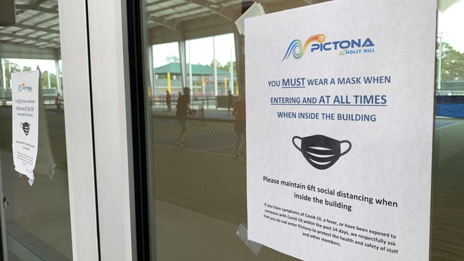 Notices on the doors at the new Pictona at Hally Hill pickleball complex remind members and visitors that masks are required inside the building on Tuesday, July 14, 2020.