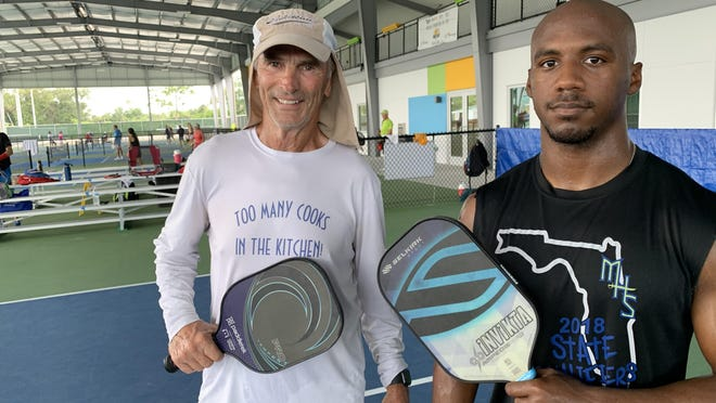 Bill Cook, left, and Elijah White take a break from playing doubles on the covered courts at the new Pictona at Holly Hill pickleball complex on Tuesday, July 14, 2020. The $6.2 million facility that features 24 pickleball courts opens to the public on Wednesday, July 15, 2020.