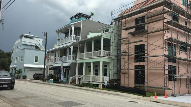 Several people who live in new townhomes off Canal Street in downtown New Smyrna Beach say they've had problems with aggressive panhandlers and homeless people who hang around the riverfront neighborhood. Pictured are townhomes on Faulkner Street.