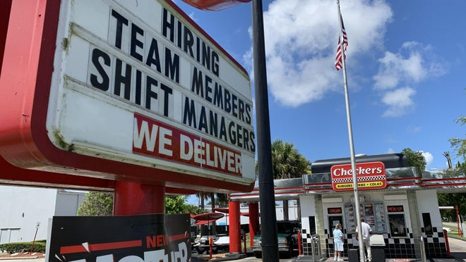 A hiring sign for the Checkers fast-food restaurant at 898 N. Nova Road in Daytona Beach can be seen on Monday, July 20, 2020.