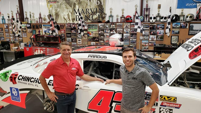 Dan Pardus, left, and his 23-year-old son Preston stand next to the car that made its NASCAR Xfinity Series debut last year. The car sports No. 36 this season.