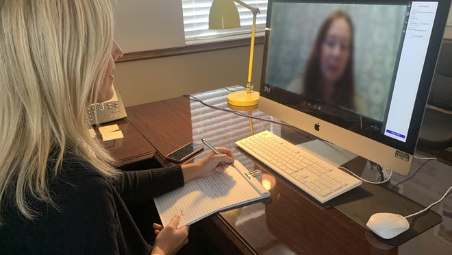 Jennifer Stephenson, senior director of outpatient services for SMA Healthcare, meets with a client through Lifesize, a HIPAA-compliant video conferencing platform.