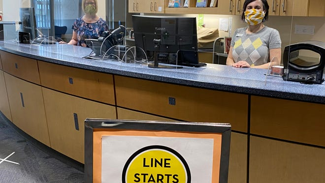 The Cuyahoga Falls Library now requires all patrons age 2 and up to wear masks. Pictured from left are: Elizabeth Sucharzewski, Children's Department Manager and Missy Littell, Customer Experience Manager, when the library reopened after the pandemic shutdown in July 2020.