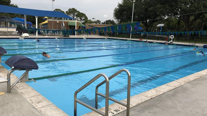 Swimmers returned to the City of Palm Beach Gardens' Aquatic Complex Wednesday. The facility has reopened to lap swimmers, while parks, golf courses and some other recreational facilities also have opened.