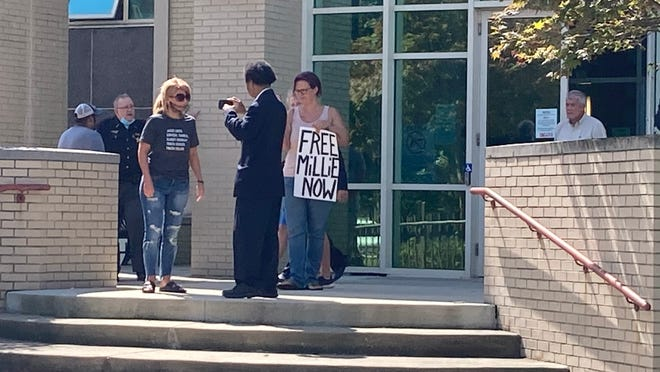 A handful of people protested outside of the Portage County Courthouse in Ravenna on Monday in support of Millicent Weaver, an InfoWars correspondent who was arrested over the weekend in Palmyra Township.