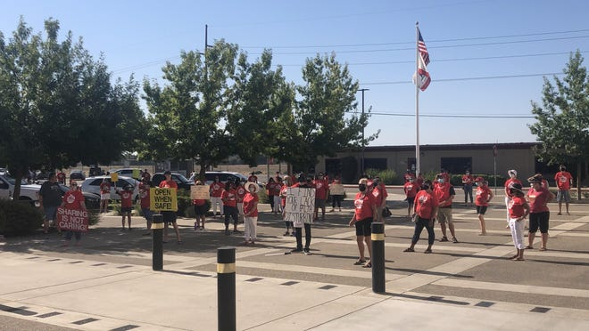 Manteca Unified School District teachers demonstrated outside the district office Tuesday.